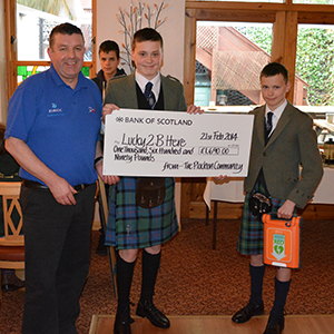 Ross receiving a donation cheque